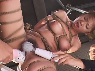 Busty Japanese Woman tied up and pussy abused