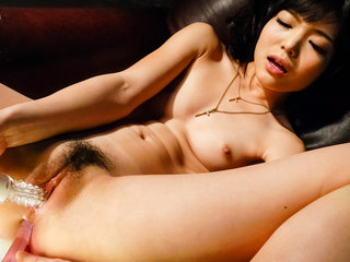 Sweet Megumi Shino stuffs a vibrator deep into her humid..